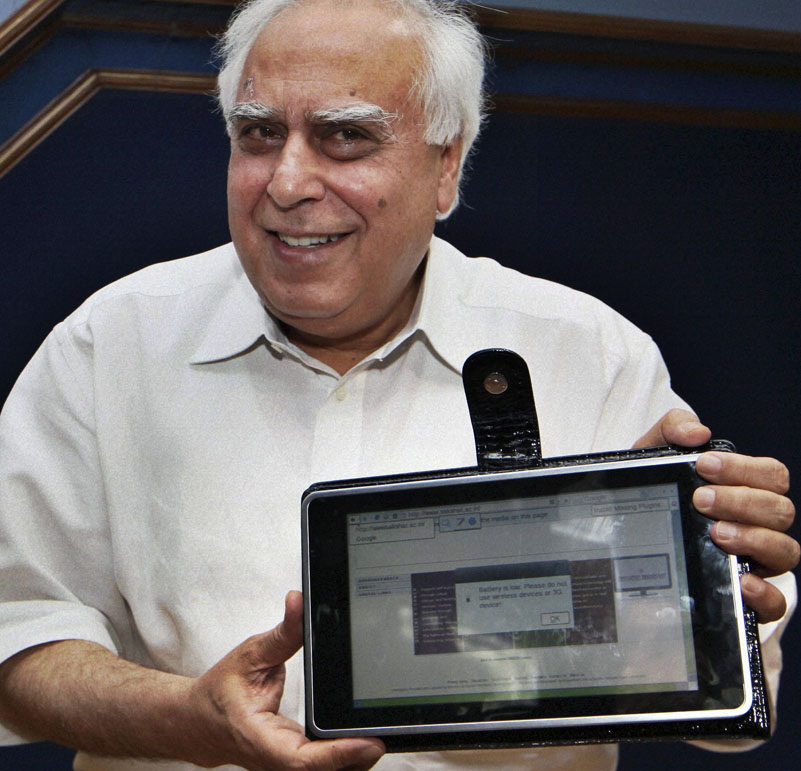 India's Human Resource Development Minister Kapil Sibal displays a basic touch-screen tablet aimed at students, which it hopes to bring into production by 2011. The device looks like an iPad and is 1/14th the cost.