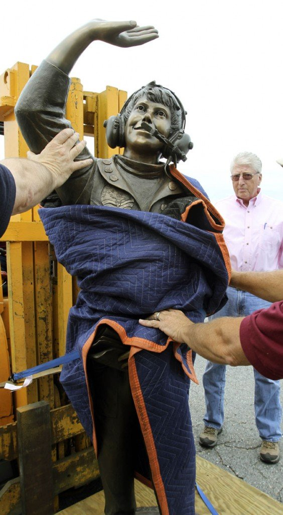 A bronze statue of the late Vicki Van Meter is delivered to the Augusta State Airport today. Her father, Jim Van Meter of St. George, Utah, watches in the background.