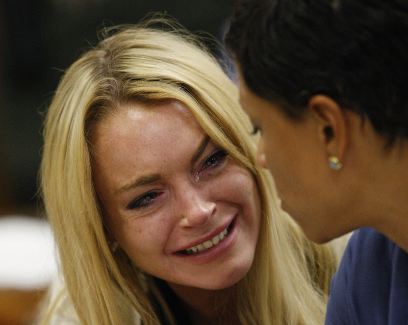 Actress Lindsay Lohan cries at a hearing in Beverly Hills, Calif., on Tuesday, where she was sentenced to 90 days in jail and a rehab program for violating terms of her probation.