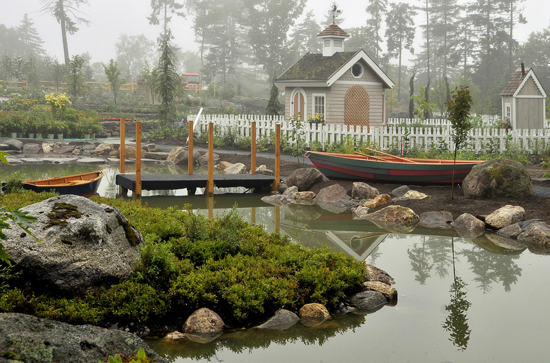 A created pond with docks and boats lies at the center of the new Children's Garden at Coastal Maine Botanical Gardens. In back is