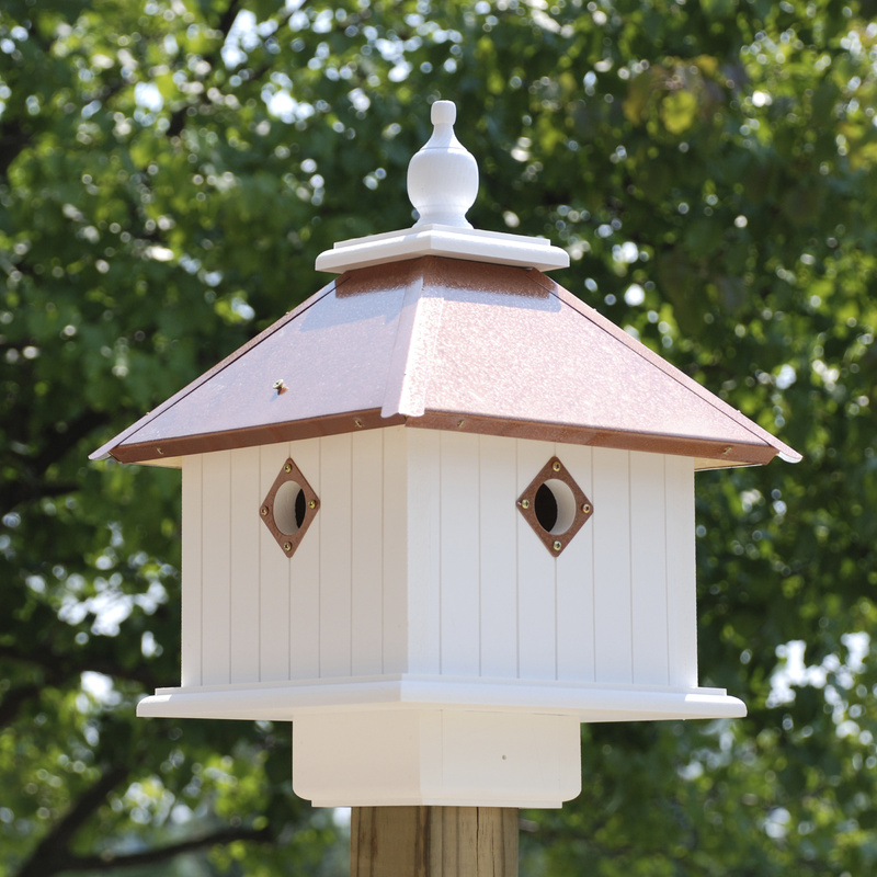 """BestNest.com's carriage house birdhouse, which has four """"apartments"""""""