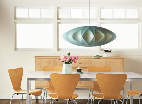 """Vintage lighting (such as this George Nelson pendant from the mid-20th century) is fantastic,"" says interior designer Betsy Burnham, but old lampshades should be replaced with fresh ones to ""enhance your vintage stuff, make it beautiful again."""