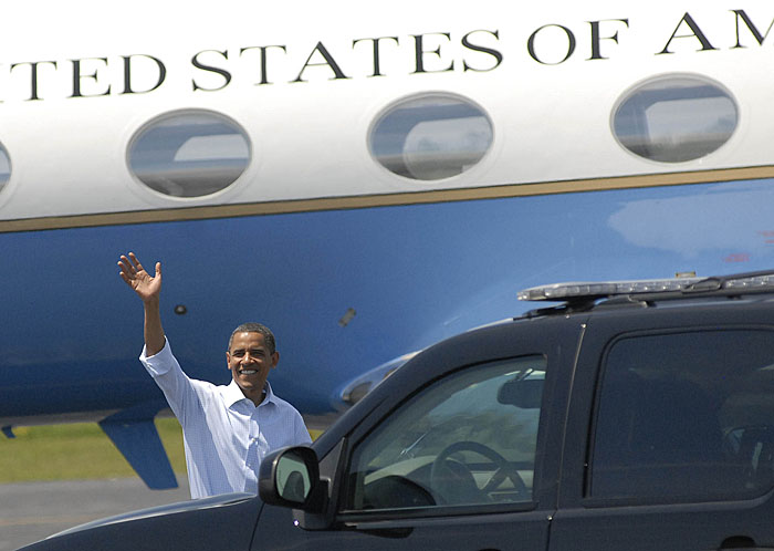 President Obama waves to the press upon arriving in Trenton.