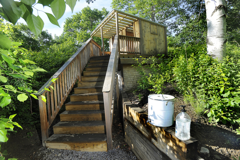 Outhouses at the Rippleffect compound on Cow Island in Casco Bay include this one called the Hipper. The two-room commode offers grand views of sea and sky.
