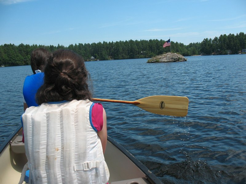 """Our approach to """"Poop Rock."""" The kids wanted to get a closer look at all the boulders and islands out on the lake."""