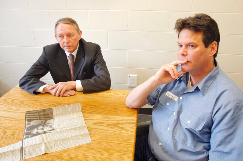 Accompanied by his attorney Steve Peterson, Dennis Dechaine listens to a reporter's questions during an interview at the Maine State Prison in Warren on March 22. With a new appeal more than two decades after his conviction in the death of Sarah Cherry, no other case has been litigated in Maine's court system for so long.