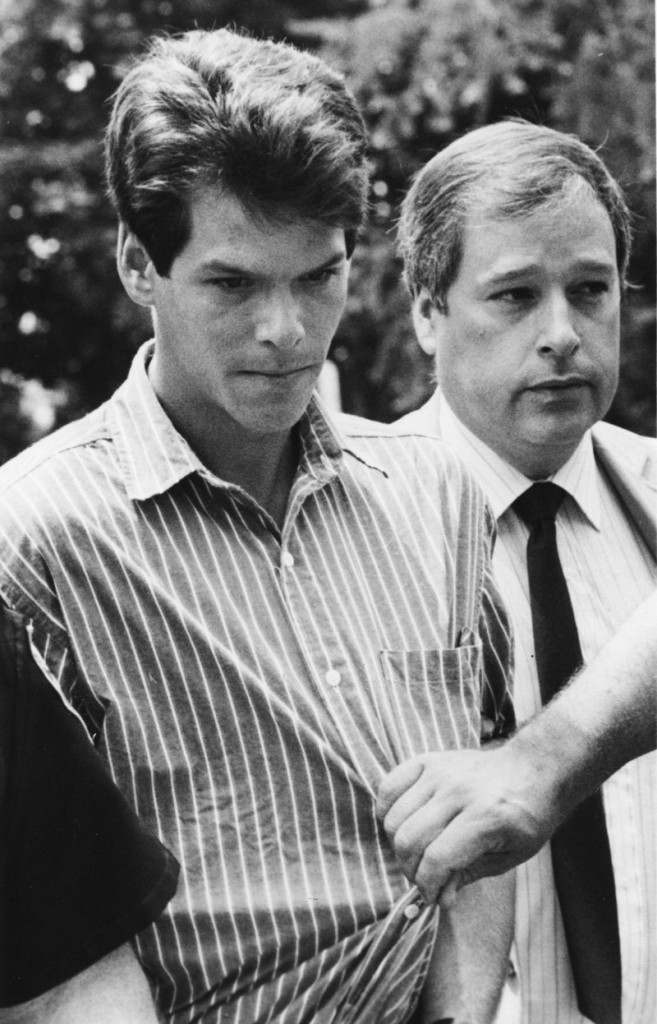 Thirty-year-old Dennis Dechaine of Bowdoinham is escorted to his arraignment in the slaying of 12-year-old Sarah Cherry on July 12, 1988, four days after his arrest. Dechaine has been in custody since.