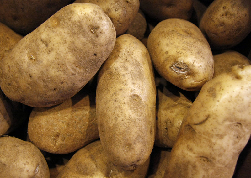 Maine farmers and leaders want white potatoes, like these at Rosemont Market in Portland, to be listed once again as a qualifying food in the Women, Infants and Children Program.