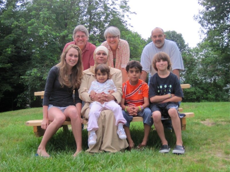 The American Friend program arranged for a Maine family to help an Iraqi family navigate Portland. In front from left are Charlotte Spritz, Zaineb Marwan, Mariam Quasem, Ahmed Quasem and Henry Spritz. In the rear from left are John Spritz, Helen Pelletier and Luay Mohammed.