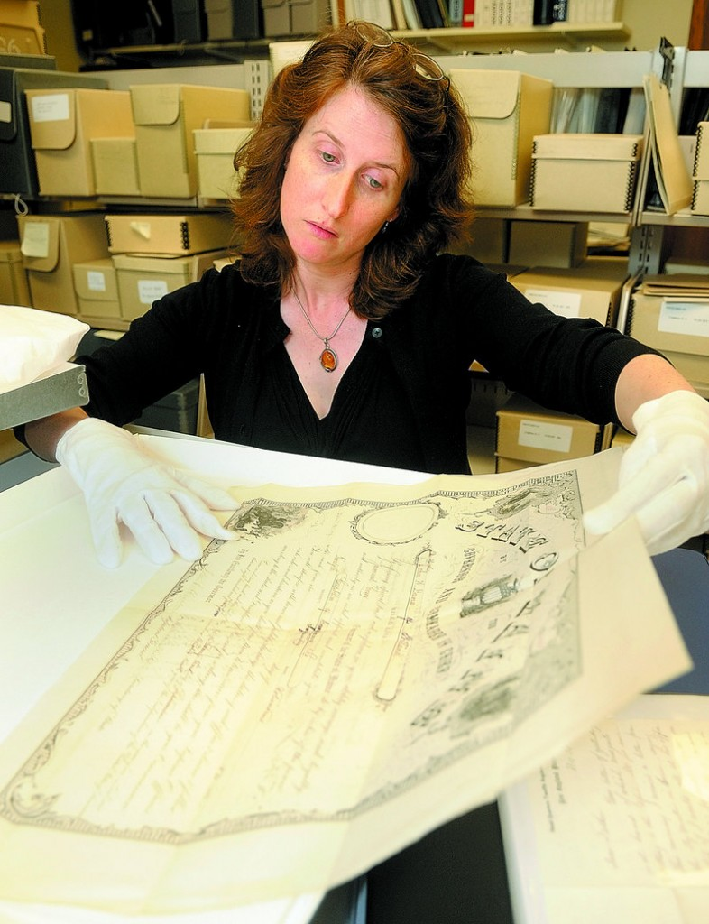 Kate McBrien, curator of historic collections, shows John Dana's discharge from the Union Army at the Maine State Museum in Augusta. The museum recently purchased a collection of Dana's Civil War letters and other artifacts.