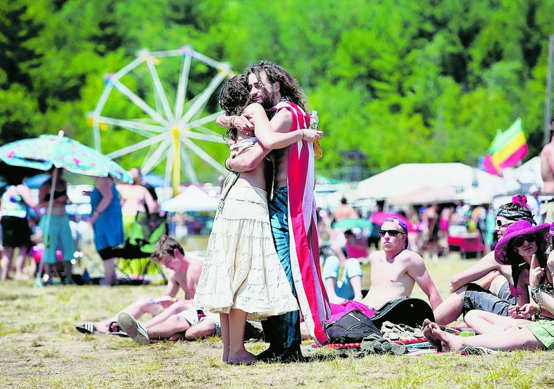 Noel Sanborn of West Hartford, Conn., gets a hug from Mark Nastasi of Burlington, Vt., who was giving out hugs and free massages during the festival.