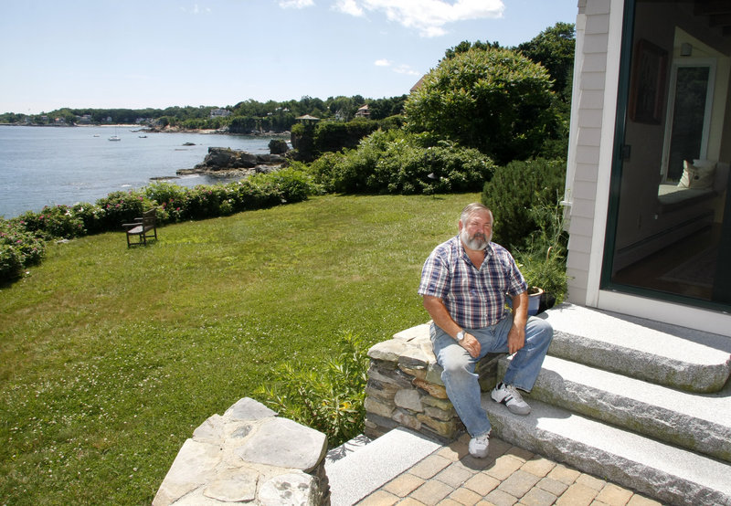 Bob Blackwood's property, located on a cliffside high off the ocean on Cloyster Street in South Portland, is in a newly designated floodplain zone.