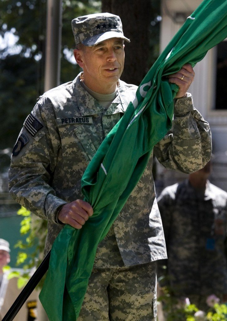 Gen. David Petraeus accepted command of U.S. and NATO forces in Afghanistan on Sunday.