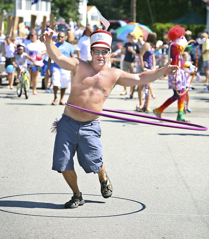 Scott Belanger of Ocean Park shows off his hula hoop skills with the group Hoopsters during the 60th annual Independence Day Community Parade in Ocean Park on Monday.