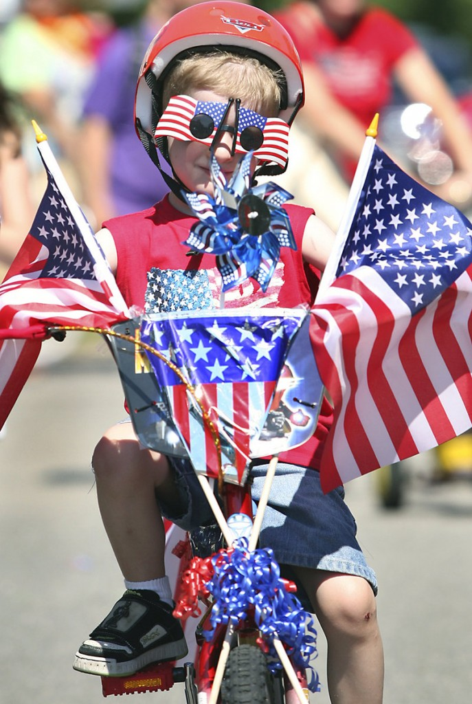 Joey Martellucci, 5, of North Andover, Mass., rides his bike during the Independence Day parade in Ocean Park on Monday. Joey entered his bike in the Decorated Bicycle Contest and rode with the other contest participants.