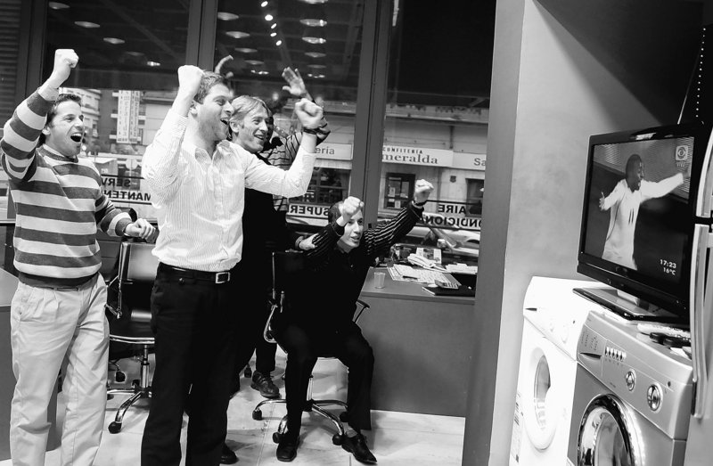 The Associated Press Sales workers at an appliance store in Montevideo, Uruguay, celebrate a goal by their nation's team during a World Cup match against South Africa on June 16.