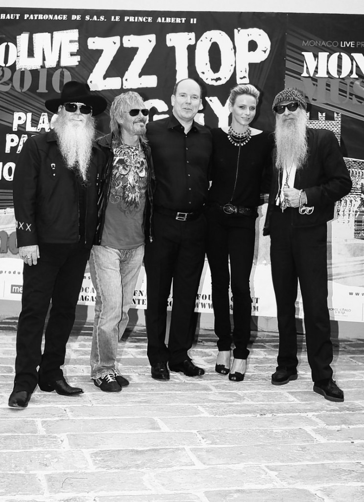 American blues rock trio ZZ Top pose with Prince Albert II of Monaco, center, and his fiancee, Charlene Wittstock, before giving an open-air concert Monday in Monaco.