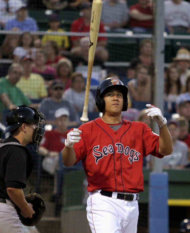 Chih-Hsien Chiang of Portland shows his frustration after striking out in the eighth inning against New Hampshire on Monday night at Hadlock Field. The Dogs lost, 5-3.