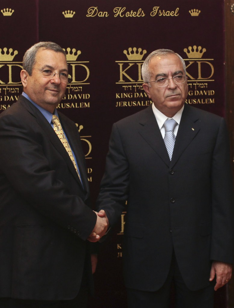 Israeli Defense Minister Ehud Barak, left, meets with Palestinian Prime Minister Salam Fayyad in Jerusalem on Monday, as Israel redefined the rules of its controversial Gaza Strip embargo.