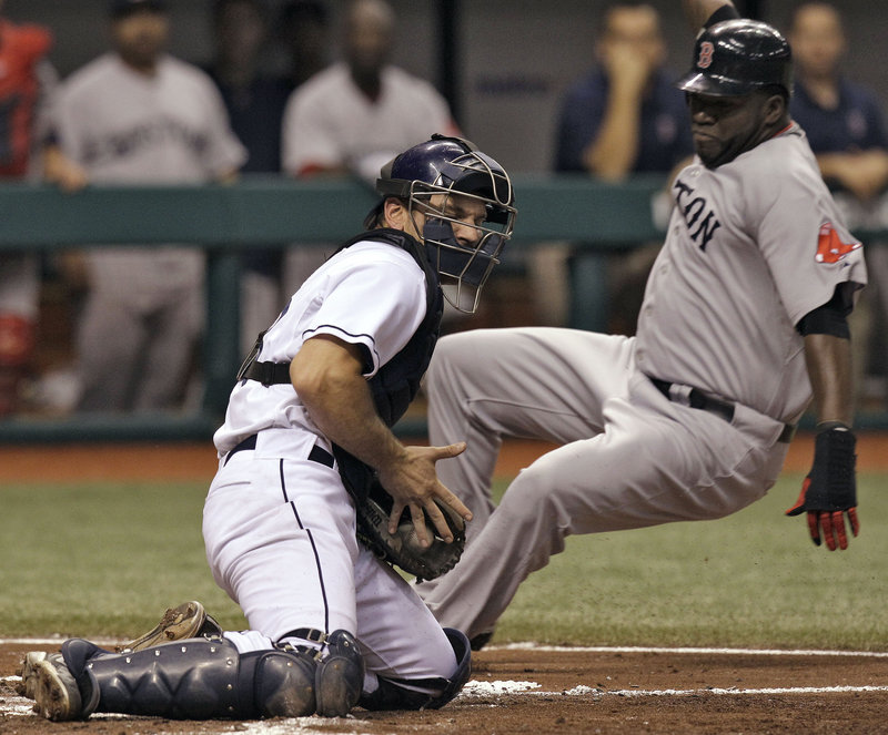 David Ortiz scores ahead of the tag by Tampa Bay's John Jaso in the third inning Monday night at St. Petersburg, Fla. The Rays rallied for a 6-5 win.