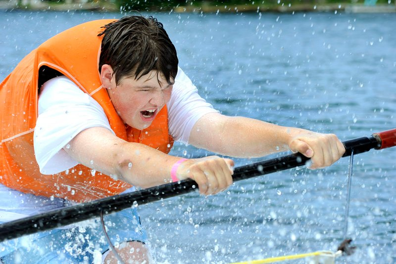 Fifteen-year-old Richard Danis of Saco gets up on a pair of skis for the first time. In His Wakes is a Christian organization that gives at-risk youths the chance to participate in water-related activities.