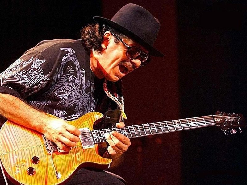 Carlos Santana performs with Steve Winwood on July 23 in Mansfield, Mass.
