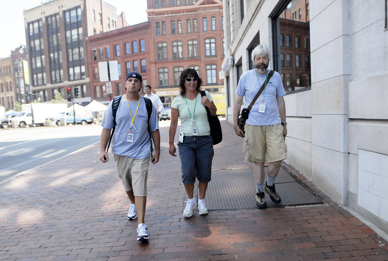 From left, Jesse Flynn, Peggy Lynch and John Dana, part of the new Homeless Outreach & Mobile Engagement Team, walk along Preble Street in Portland on Wednesday. Their aim: Help the homeless and help the city.