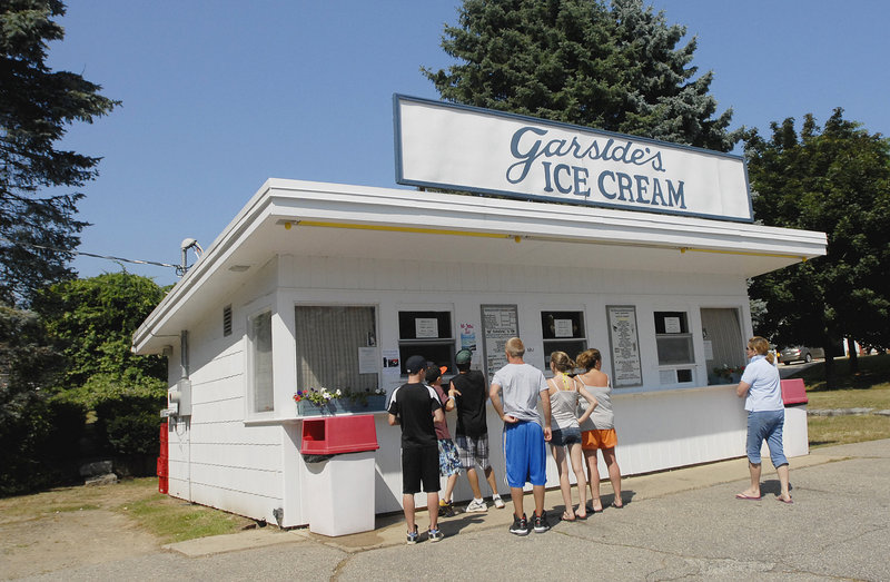 Customers at the window of an ice cream stand – in this case, Garside's in Saco – are a summer tradition. What's new are the flavors available at Maine shops, including salt caramel, Thai chili and coconut.