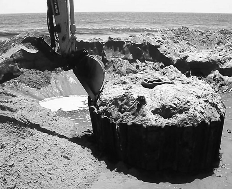 A near-shore wellhead is excavated off California so it can be recapped. There is, however, no program for recapping or inspecting abandoned wells in federal waters.