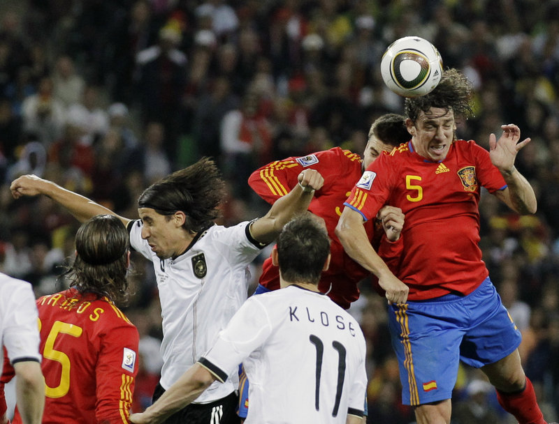 Carles Puyol of Spain thunders in to score on a corner kick Wednesday and give his team a 1-0 win over Germany.