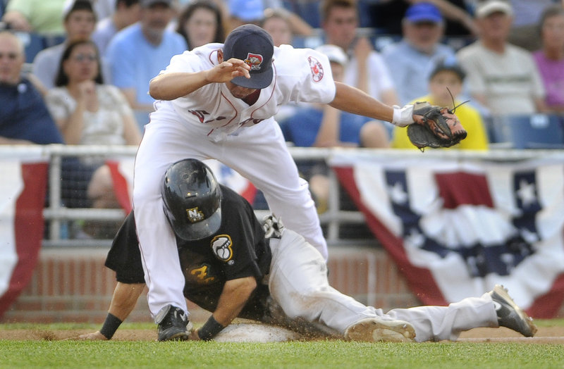 Sea Dogs third baseman Ray Chang gets tangled up with Darin Mastroianni of the Fisher Cats, who was safe during the third inning of Portland's 11-4 win Wednesday night.