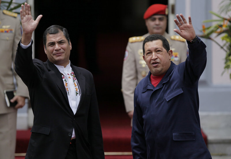 Rafael Correa, left, and Hugo Chavez