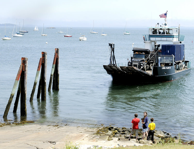 Children watch as a commercial vehicle ferry departs Thursday from the East End Boat Launch in Portland. The ferry services most of the islands in Casco Bay.