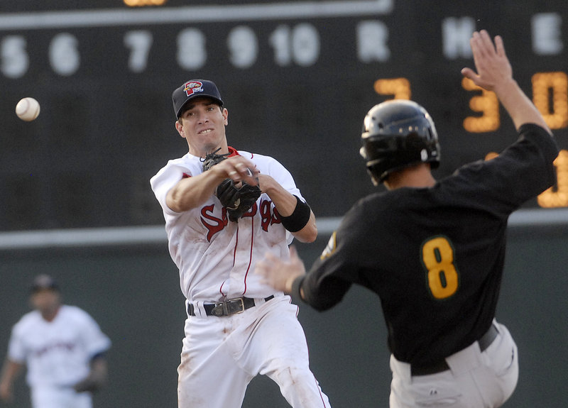 Sea Dogs second baseman Nate Spears gets the throw away past the sliding Brian Jeroloman of the Fisher Cats to complete a double play in the Cats' 8-2 win Thursday night.