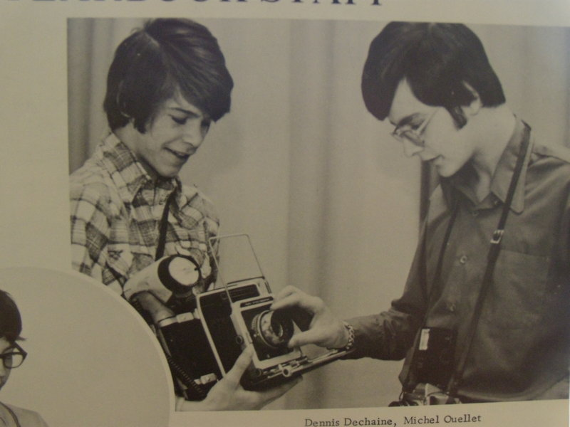In a yearbook photo from Dennis Dechaine's junior year at Madawaska High School, the teenage Dechaine, left, holds a camera that he used when he was on the yearbook staff.