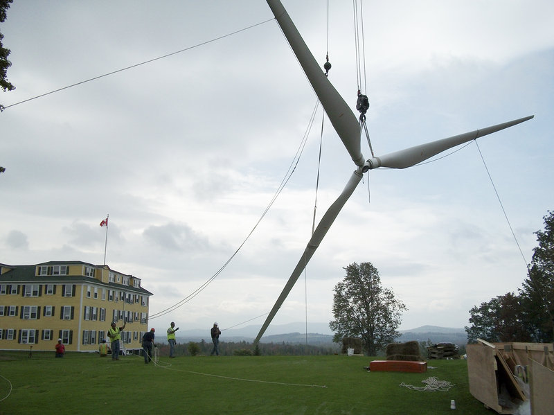 A CCB construction team hoists into place the blades for the NorthWind 100 wind turbine at the Grand Hotel in Whitefield, N.H. This is the same kind of wind turbine that CCB will install in Dennis, Mass., later this summer.
