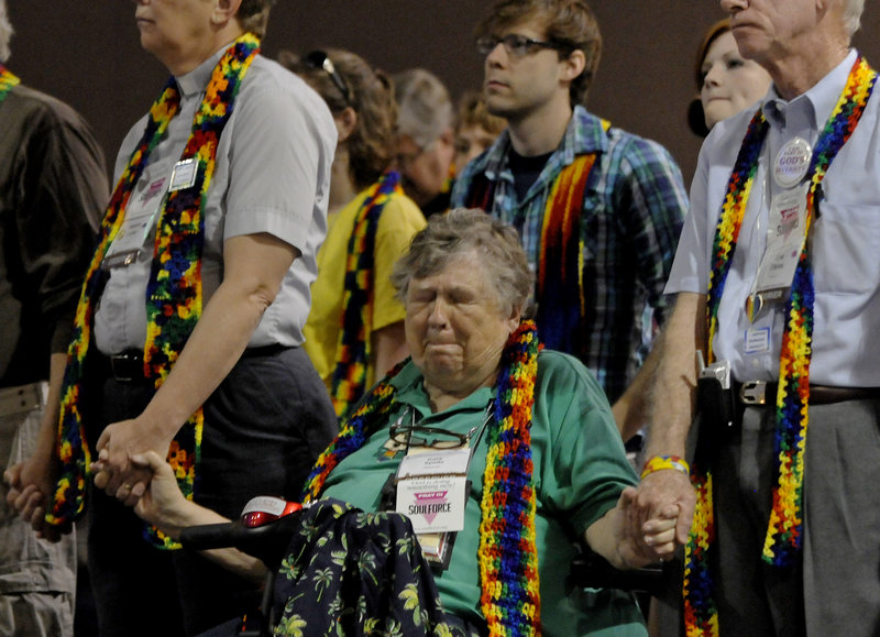 Kara Speltz of California reacts after Presbyterian leaders voted Friday in Minneapolis against a motion to redefine marriage.