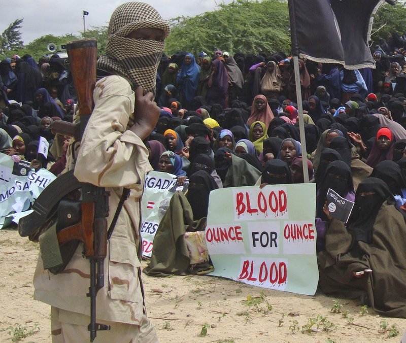 Supporters of the militant al-Shabab group shout slogans during a demonstration this week in Mogadishu, Somalia. The group is recruiting fighters among Somali communities.