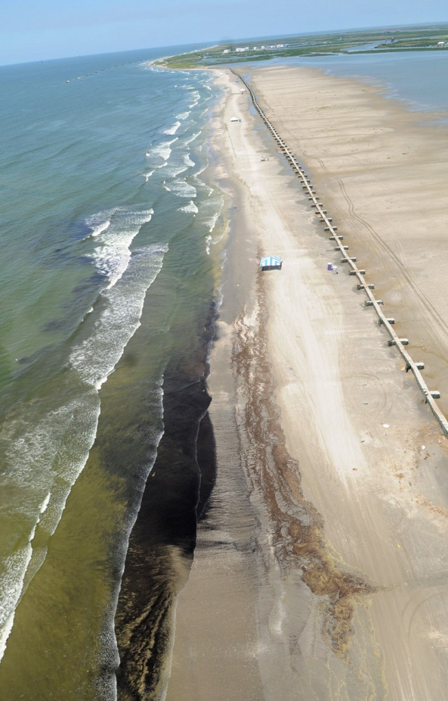 Crude oil from the Deepwater Horizon spill washes up onto Fourchon Beach, La., on Friday.