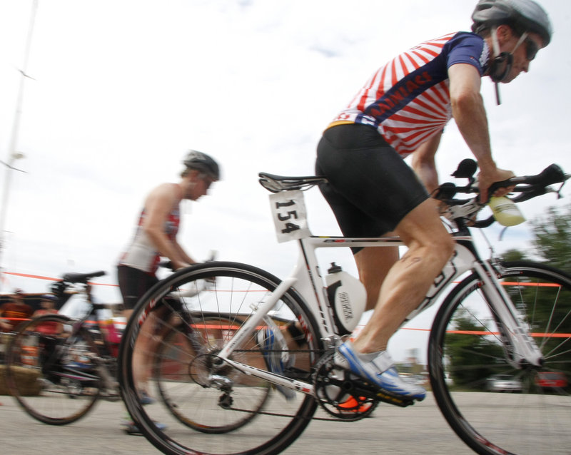 With the swim portion of the event behind them, it was on to the bicycles for the competitors in the Urban Epic Triathlon. The bikers headed out from the transition station at Portland Yacht Services, a marina in the Old Port of Portland.
