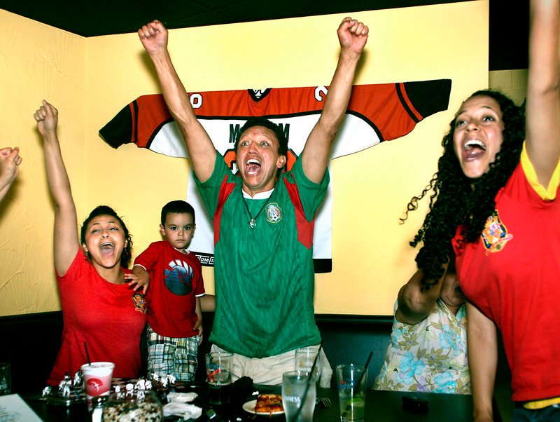 Fans around the world celebrated Spain's victory, including Byron Saavedra of Portland, who reacts to Iniesta's goal. Sharing Saavedra's enthusiasm are his daughter Nicole, left, his grandson Korben, 2, and his daughter Stefanie. The family watched the final match at G&R DiMillo's Bayside Restaurant in Portland.