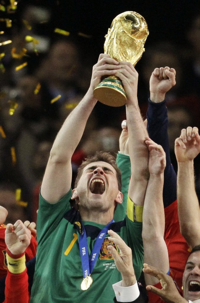 Goalkeeper Iker Casillas hoists the World Cup trophy Sunday night in a moment that Spain, with its long history of disappointing finishes in major tournaments, met with both relief and jubilation.
