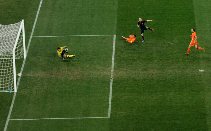A shot by Andres Iniesta of Spain, second from right, crosses the goal line as Dutch keeper Maarten Stekelenburg watches late in extra time, sending Spain to its first World Cup title.