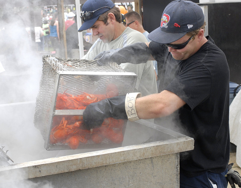 Volunteers get boiled lobsters ready for shore dinners at the 2008 festival.