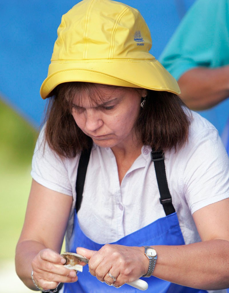 Reigning champion Beattie Quintal of Waldoboro shucks clams at the 2007 Yarmouth Clam Festival. Quintal will defend her crown in the professional division of the shucking contest on Saturday.