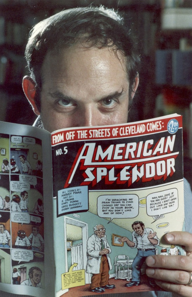 """Comic book writer Harvey Pekar poses with a copy of his """"American Splendor."""" Pekar was found dead in his Ohio home early Monday."""
