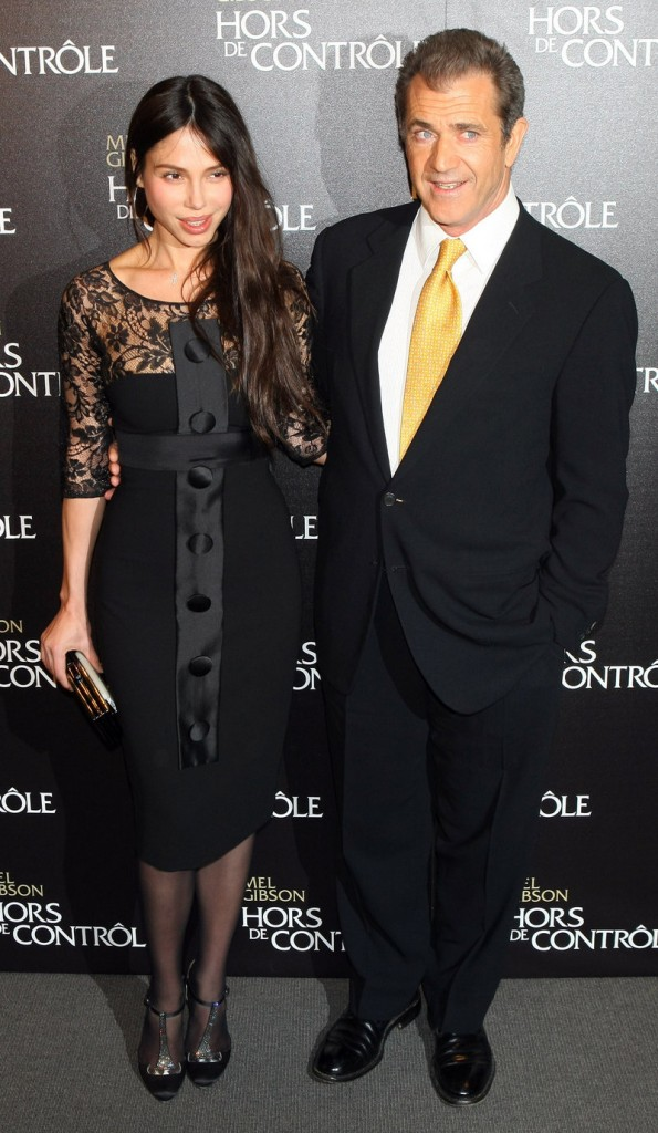 """Mel Gibson and Oksana Grigorieva arrive at the """"Edge Of Darkness"""" premiere in Paris on Feb. 4. Grigorieva, 40, a singer, has accused the actor of domestic violence."""