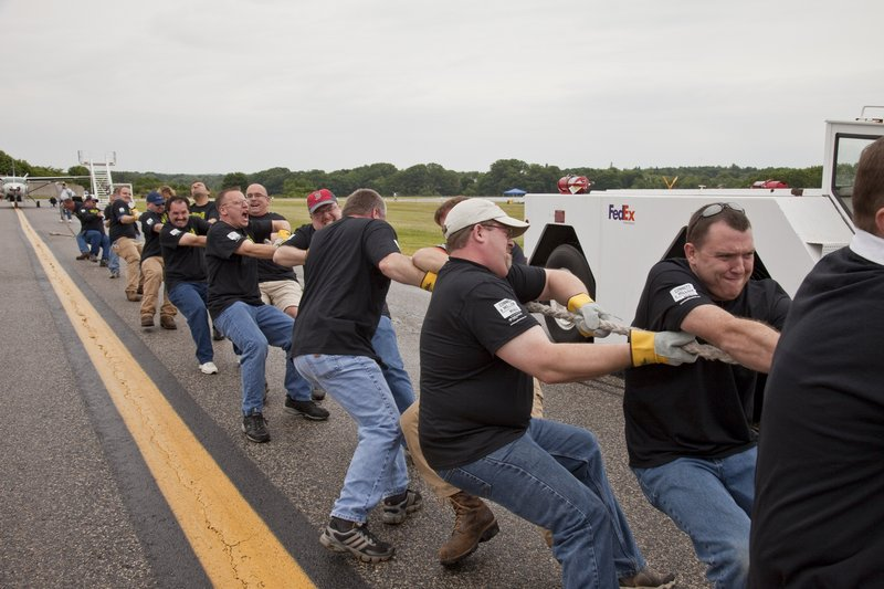 Time Warner Cable employees participate in the MS Society's Annual Plane Pull at Portland International Jetport. Time Warner Cable sponsored five teams and raised about $20,000.