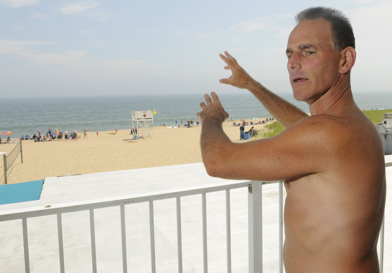Dan Mahoney of Worcester, Mass., was body boarding Monday at Old Orchard Beach when he was caught in a riptide. Cresting waves finally brought him back to shore.
