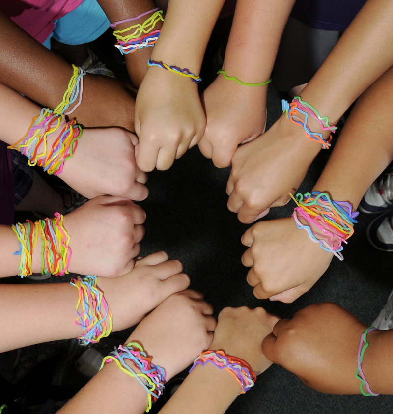 Children display their Silly Bandz at Portland's Riverton Community Center day camp. Robert Croak, founder of BCP Imports, said annual sales of the bands were $10,000 two years ago but now top $100 million.
